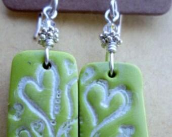 Green polymer clay earrings.