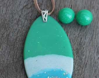 Handmade resin, leather and sterling silver pendant with matching green stud earrings