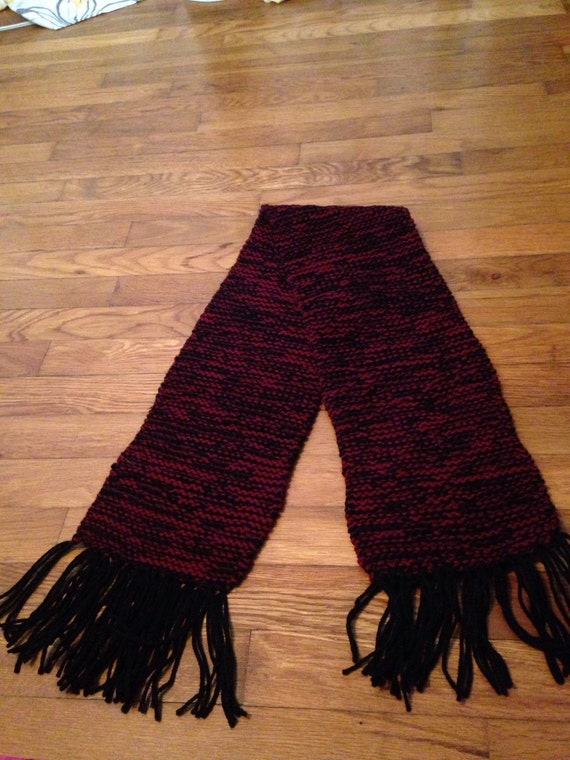 Red and black wool scarf with fringe.