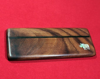 "Beard comb in the case of rosewood with inlaid mother of pearl ""Rhinoceros"""