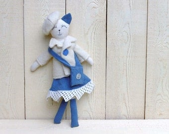 cat with coat and beret