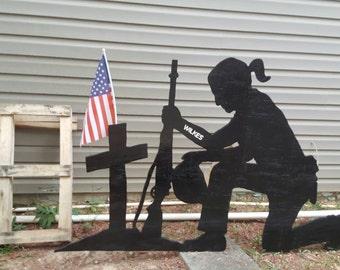 Female praying soldier at cross yard art silhouette