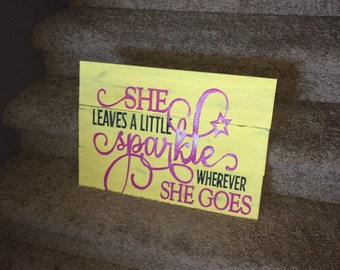 She leaves a little sparkle wherever she goes wooden sign