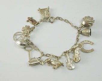 "Charm bracelet vintage sterling silver 7 1/4"" long thirteen charms 25.6 grams"