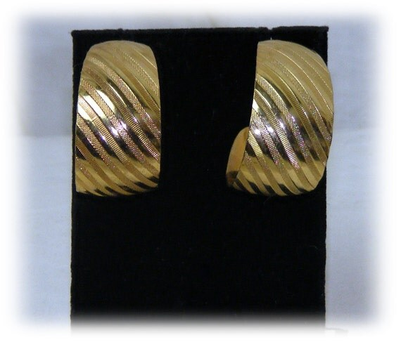 TEXTURED DESIGN EARRINGS . . Never Worn