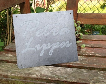 Front door sign made of slate