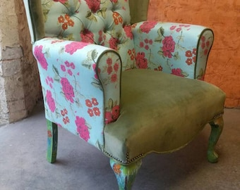 Tufed wingback armchair