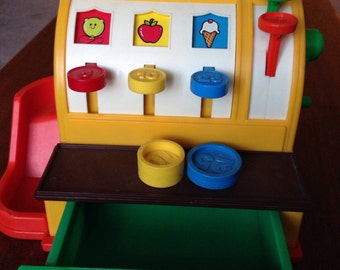 Fisher Price Cash Register, 1974. Comes with 2 original coins 25 and 10 cent pieces.