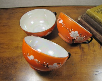 Orange Oriental Teacup - White Flower and Branch - Lusterware Inside - Set of Three (3)
