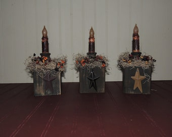 Primitive candle block with star