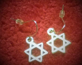 Silver Star Dangly Earrings.