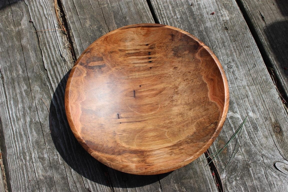 Spalted maple wood bowl with natural worm holes marbleizing