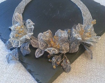 Necklace made of crochet (silver plated) wire flowers with Ganutell