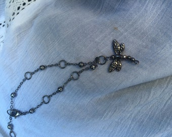 Chain link beaded bracelet with dragonfly charm