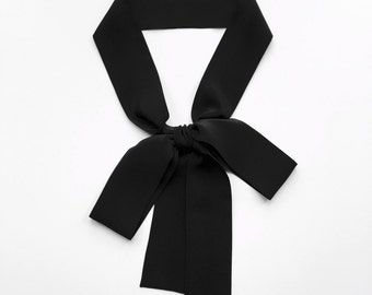 "This black bow tie scarf is 60"" x 2"" with square ends in pure silk. Skinny scarves are versatile as a sash, choker tie or headscarf."