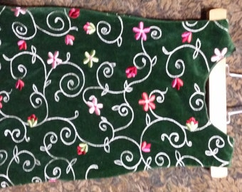 Little girl green velvet vintage holiday dree, adorned with  the cutest, multi colorful daisy flowers.