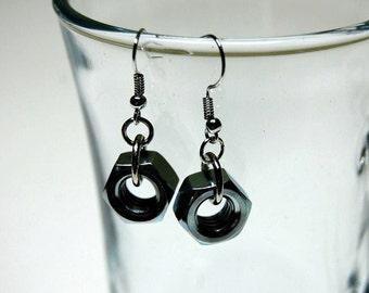 Pair earrings of silver hex nuts