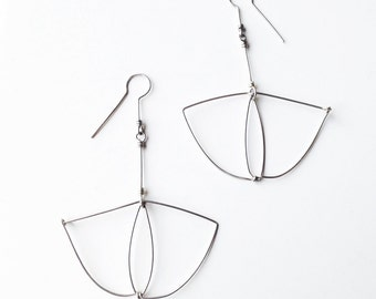 Sterling silver earrings. Offered Delivery.