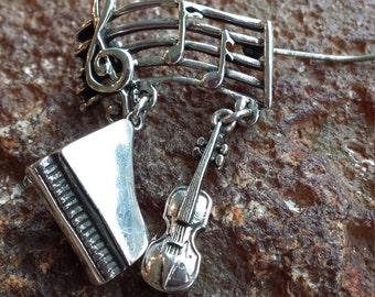 Sterling silver vintage musical brooch
