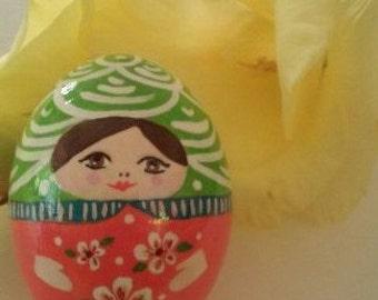 Green and pink egg babushka