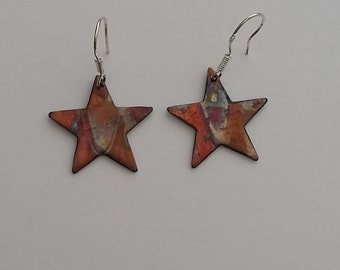 Heat colored, copper earrings, with sterling silver hook.
