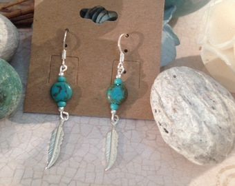 Boho feather drop earrings with teal blue beads