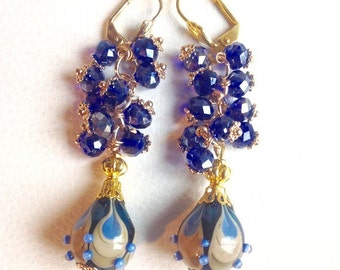 Beautiful blue and gold earrings with lampwork beads and crystal