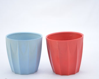 AB ware bakelite eggcups x 2, one red, one blue, from the 1940s
