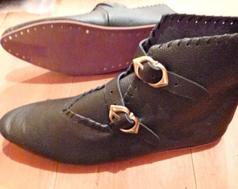 Medieval shoes with brass buckles