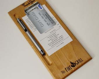 Custom check presenters with logo.  Branded wood check presenter. Laser engraving. Unique guest check book. Check holder.