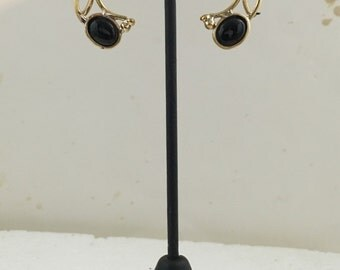 Sterling silver circle stud earrings with brass wire design and black onyx stones