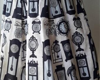 woman's box pleat skirt, clocks and lace
