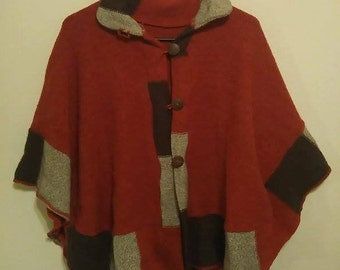 Peruvian Poncho. Wooden buttons down the front. Woolen with patchwork.