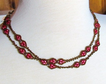 beautiful multi-string necklace with little garnets