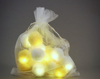 20 pom-pom LED fairy lights in yellow and  white pom-poms.
