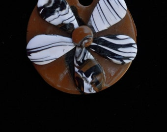 brown, black, white abstract flower pendent