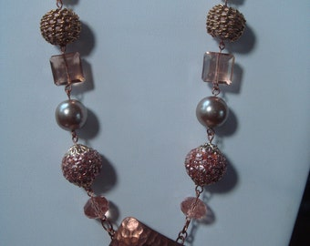 Copper beaded necklace with front toggle clasp