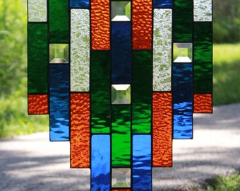 Gator inspired stained glass sun catcher; orange and blue