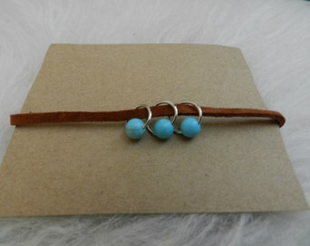 Brown suede bracelet with turquoise charms