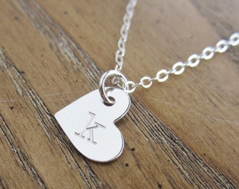 Heart shaped letter necklace with custom charms. Personalized gift for Mom with childrens initials.