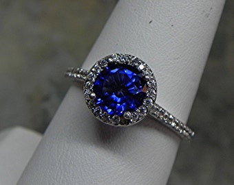 AAA Blue Sapphire   7.00 mm  1.41 Carats   Manmade 14K white gold Halo ring with .30 carats of diamonds MMM