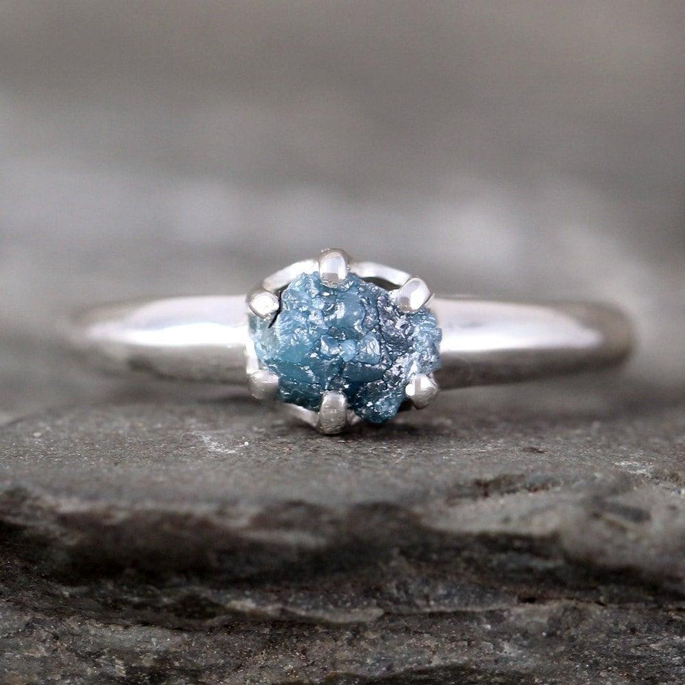 raw blue diamond ring uncut rough blue diamond conflict