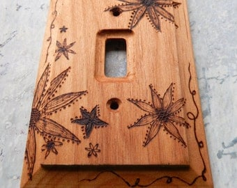 Flowers, wood burned switch plate cover, natural wood with free hand drawings of stylized flowers burned into the surface