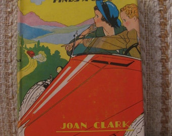 Penny Nichols Finds a Clue by Joan Clark