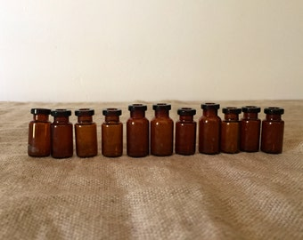 Twelve tiny amber apothecary bottles. Vintage / Industrial decor.