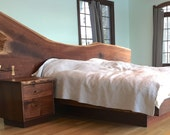 Natural edge walnut bed set with solid bronze accents.
