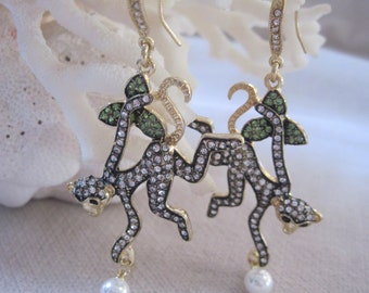 Playful Monkey Hanging from a Leaf Branch with Coconut Earrings