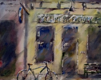 "Storefront, street scene, architecture, yellow, bicycle. Key Lime Pie Factory. - Original Watercolor Painting 12"" x 12""."