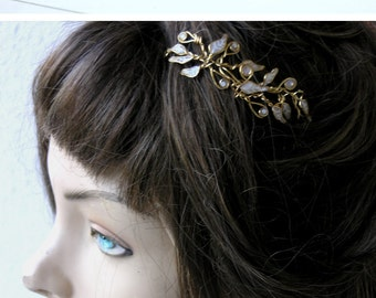 Bridal head piece. Bridal hair piece. Bridal hairpiece. Wedding shops. Taira.