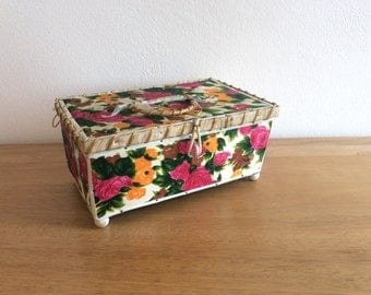 Vintage mid-century sewing box or jewel box with floral fabric cover and padded satin lining